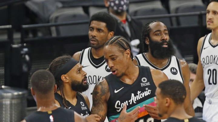 San Antonio Spurs Lonnie Walker Patty Mills DeMar DeRozan Dejounte Murray (Photo by Ronald Cortes/Getty Images)