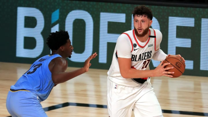 LAKE BUENA VISTA, FLORIDA – JULY 31: Jaren Jackson Jr. #13 of the Memphis Grizzlies defends Jusuf Nurkic #27 of the Portland Trail Blazers during the second half at The Arena. (Photo by Mike Ehrmann/Getty Images)