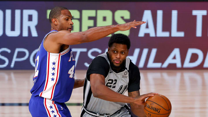 LAKE BUENA VISTA, FLORIDA – AUGUST 03: Rudy Gay #22 of the San Antonio Spurs is defended by Al Horford #42 of the Philadelphia 76ers during the first quarter at Visa Athletic Center. (Photo by Mike Ehrmann/Getty Images)