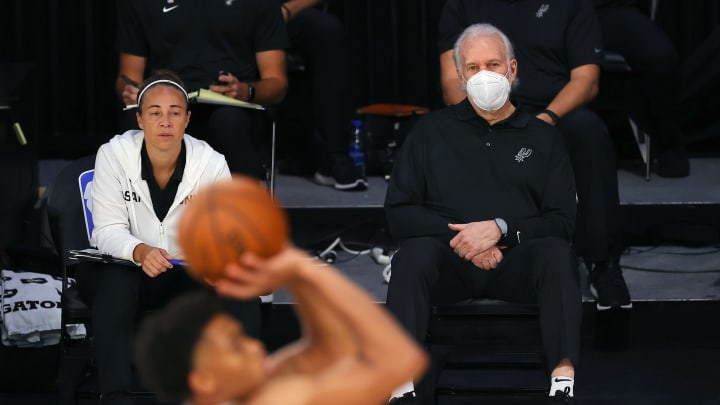 LAKE BUENA VISTA, FLORIDA – AUGUST 03: Head coach Gregg Popovich of the San Antonio Spurs looks on against the Philadelphia 76ers during the second quarter at Visa Athletic Center. (Photo by Mike Ehrmann/Getty Images)