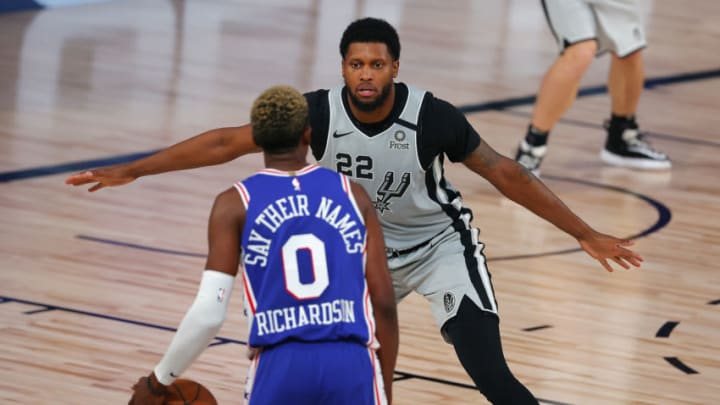 LAKE BUENA VISTA, FLORIDA - AUGUST 03: Rudy Gay #22 of the San Antonio Spurs defends Josh Richardson #0 of the Philadelphia 76ers during the second quarter at Visa Athletic Center at ESPN Wide World Of Sports Complex on August 03, 2020 in Lake Buena Vista, Florida. NOTE TO USER: User expressly acknowledges and agrees that, by downloading and or using this photograph, User is consenting to the terms and conditions of the Getty Images License Agreement. (Photo by Mike Ehrmann/Getty Images)