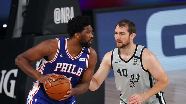 LAKE BUENA VISTA, FLORIDA – AUGUST 03: Joel Embiid #21 of the Philadelphia 76ers is defended by Tyler Zeller #40 of the San Antonio Spurs during the second quarter at Visa Athletic Center. (Photo by Mike Ehrmann/Getty Images)
