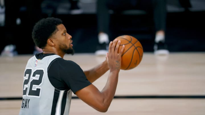 LAKE BUENA VISTA, FLORIDA - AUGUST 03: Rudy Gay #22 of the San Antonio Spurs attempts a free throw against the Philadelphia 76ers during the second quarter at Visa Athletic Center at ESPN Wide World Of Sports Complex on August 03, 2020 in Lake Buena Vista, Florida. NOTE TO USER: User expressly acknowledges and agrees that, by downloading and or using this photograph, User is consenting to the terms and conditions of the Getty Images License Agreement. (Photo by Mike Ehrmann/Getty Images)