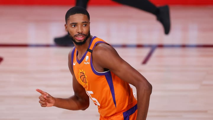 LAKE BUENA VISTA, FLORIDA – AUGUST 06: Mikal Bridges #25 of the Phoenix Suns reacts after a slam dunk during the second quarter the Indiana Pacers at Visa Athletic Center. (Photo by Kevin C. Cox/Getty Images)