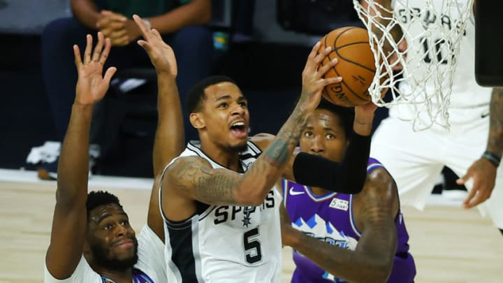 LAKE BUENA VISTA, FLORIDA - AUGUST 07: Dejounte Murray #5 of the San Antonio Spurs drives to the basket against the Utah Jazz at HP Field House at ESPN Wide World Of Sports Complex. (Photo by Kevin C. Cox/Getty Images)