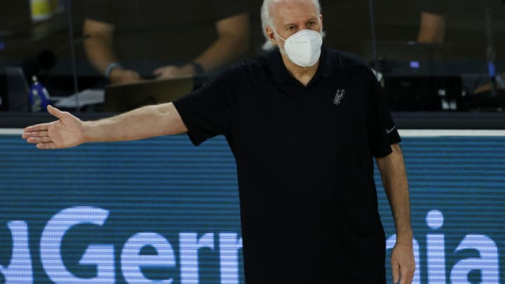 LAKE BUENA VISTA, FLORIDA - AUGUST 07: Gregg Popovich of the San Antonio Spurs reacts during the during the third quarter against the Utah Jazz at HP Field House at ESPN Wide World Of Sports Complex on August 07, 2020 in Lake Buena Vista, Florida. NOTE TO USER: User expressly acknowledges and agrees that, by downloading and or using this photograph, User is consenting to the terms and conditions of the Getty Images License Agreement. (Photo by Kevin C. Cox/Getty Images)