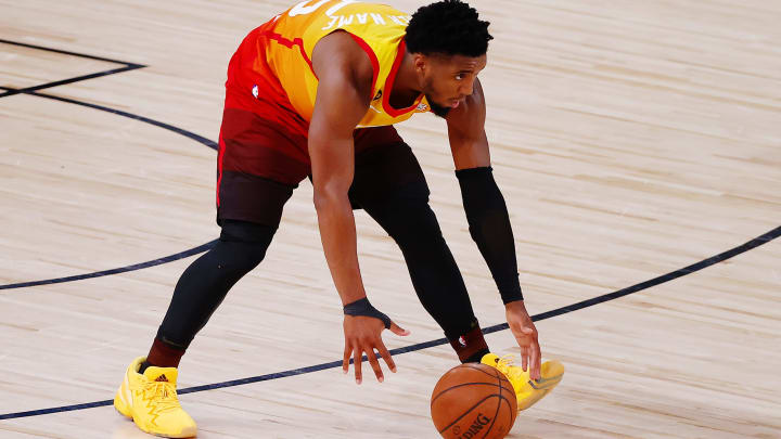 LAKE BUENA VISTA, FLORIDA – AUGUST 08: Donovan Mitchell #45 of the Utah Jazz lets the ball roll up the court. (Photo by Kevin C. Cox/Getty Images)