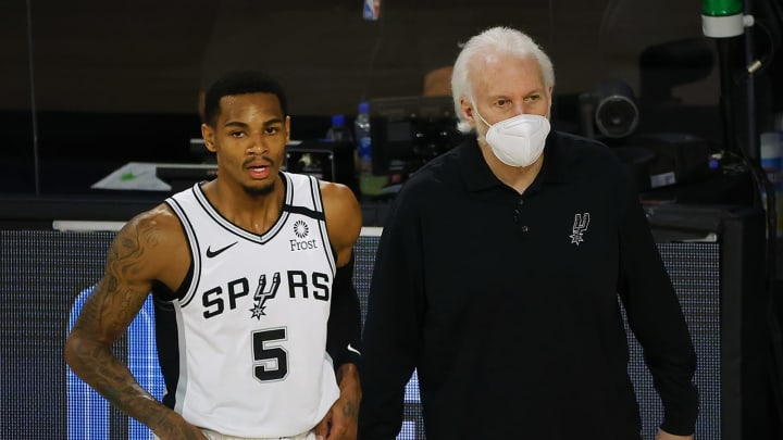 LAKE BUENA VISTA, FLORIDA – AUGUST 13: Gregg Popovich of the San Antonio Spurs talks with Dejounte Murray #5 against the Utah Jazz at ESPN Wide World Of Sports Complex in 2020. (Photo by Kevin C. Cox/Getty Images)