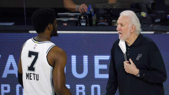 LAKE BUENA VISTA, FLORIDA - AUGUST 13: Gregg Popovich of the San Antonio Spurs talks with Chimezie Metu #7 of the San Antonio Spurs on the sidelines during the first quarter against the Utah Jazz at The Field House at ESPN Wide World Of Sports Complex on August 13, 2020 in Lake Buena Vista, Florida. NOTE TO USER: User expressly acknowledges and agrees that, by downloading and or using this photograph, User is consenting to the terms and conditions of the Getty Images License Agreement. (Photo by Kevin C. Cox/Getty Images)