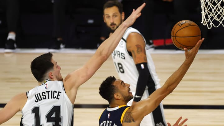 LAKE BUENA VISTA, FLORIDA - AUGUST 13: Nigel Williams-Goss #0 of the Utah Jazz attempts a drive against Drew Eubanks #14 of the San Antonio Spurs during the third quarter at The Field House. (Photo by Kevin C. Cox/Getty Images)