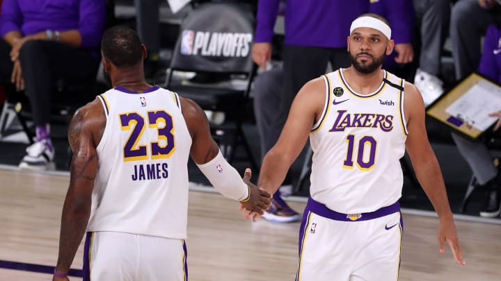 LAKE BUENA VISTA, FLORIDA – SEPTEMBER 12: LeBron James #23 of the Los Angeles Lakers high fives Jared Dudley #10 of the Los Angeles Lakers during the fourth quarter in Game Five of the Western Conference Second Round during the 2020 NBA Playoffs at AdventHealth Arena. (Photo by Michael Reaves/Getty Images)