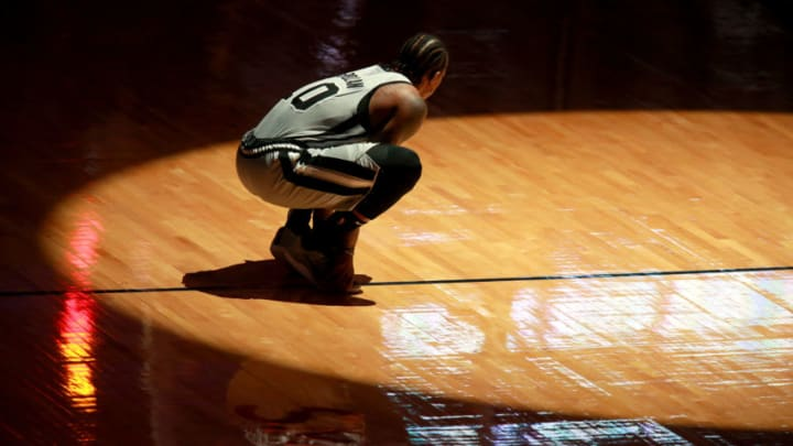 NEW ORLEANS, LOUISIANA - DECEMBER 27: DeMar DeRozan #10 of the San Antonio Spurs kneels on the court prior to the start of an NBA game against the New Orleans Pelicans at Smoothie King Center on December 27, 2020 in New Orleans, Louisiana. NOTE TO USER: User expressly acknowledges and agrees that, by downloading and or using this photograph, User is consenting to the terms and conditions of the Getty Images License Agreement. (Photo by Sean Gardner/Getty Images)