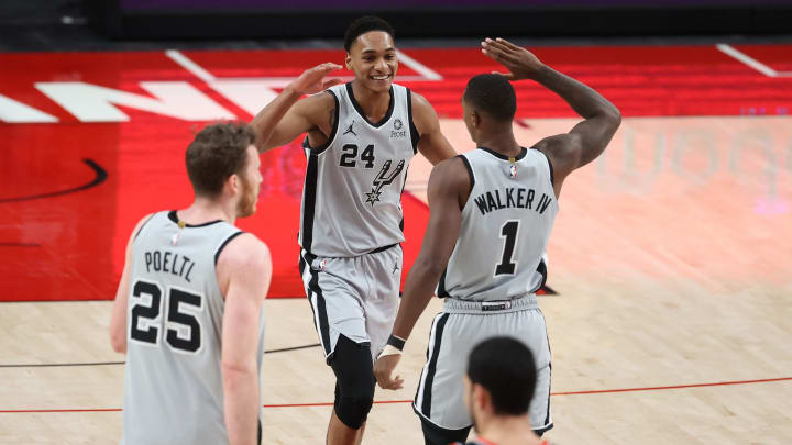 PORTLAND, OREGON – JANUARY 18: Devin Vassell #24 and Lonnie Walker IV #1 of the San Antonio Spurs high five in the fourth quarter against the Portland Trail Blazers at Moda Center. (Photo by Abbie Parr/Getty Images)