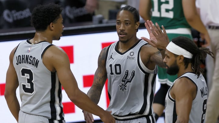 San Antonio Spurs Keldon Johnson DeMar DeRozan Patty Mills (Photo by Tom Pennington/Getty Images)