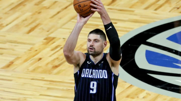 ORLANDO, FL - MARCH 03: Nikola Vucevic #9 of the Orlando Magic shoots the ball against the Atlanta Hawks at Amway Center on March 3, 2021 in Orlando, Florida. NOTE TO USER: User expressly acknowledges and agrees that, by downloading and or using this photograph, User is consenting to the terms and conditions of the Getty Images License Agreement. (Photo by Alex Menendez/Getty Images)