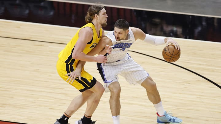 MIAMI, FLORIDA – MARCH 11: Nikola Vucevic #9 of the Orlando Magic is defended by Kelly Olynyk #9 of the Miami Heat during the first quarter at American Airlines Arena on March 11, 2021 in Miami, Florida. (Photo by Michael Reaves/Getty Images)