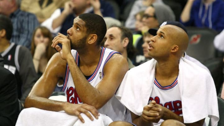 NEWARK, NJ - FEBRUARY 11: (L-R) Tim Duncan #21 and Richard Jefferson #24 of the San Antonio Spurs look on from the bench against the New Jersey Nets at Prudential Center on February 11, 2012 in Newark, New Jersey. NOTE TO USER: User expressly acknowledges and agrees that, by downloading and or using this photograph, User is consenting to the terms and conditions of the Getty Images License Agreement. (Photo by Chris Chambers/Getty Images)