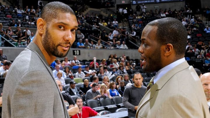 SAN ANTONIO, TX - MARCH 25: Tim Duncan #21 of the San Antonio Spurs, left, speaks to former teammate Malik Rose before a game against the Philadelphia 76ers at the AT&T Center on March 25, 2012 in San Antonio, Texas. NOTE TO USER: User expressly acknowledges and agrees that, by downloading and or using this photograph, user is consenting to the terms and conditions of the Getty Images License Agreement. Mandatory Copyright Notice: Copyright 2012 NBAE (Photos by D. Clarke Evans/NBAE via Getty Images)