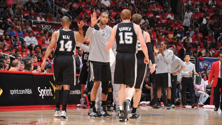 Tim Duncan of the San Antonio Spurs congratulates teammates, Gary Neal and Matt Bonner. (Photo by Andrew D. Bernstein/NBAE via Getty Images)