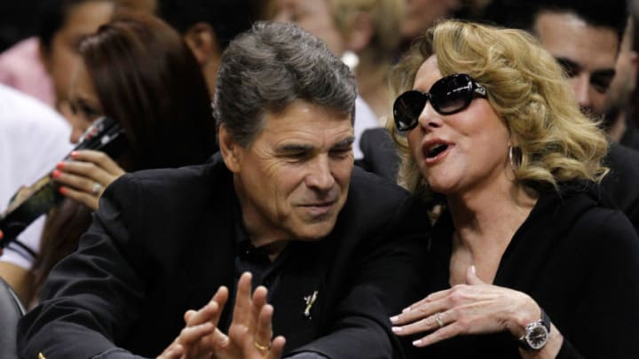 SAN ANTONIO, TX - MAY 27: Texas Gov. Rick Perry talks with the wife of the San Antonio Spurs owner Julianna Hawn Holt as the Spurs take on the Oklahoma City Thunder in Game One of the Western Conference Finals of the 2012 NBA Playoffs at AT&T Center on May 27, 2012 in San Antonio, Texas. NOTE TO USER: User expressly acknowledges and agrees that, by downloading and or using this photograph, user is consenting to the terms and conditions of the Getty Images License Agreement. (Photo by Tom Pennington/Getty Images)