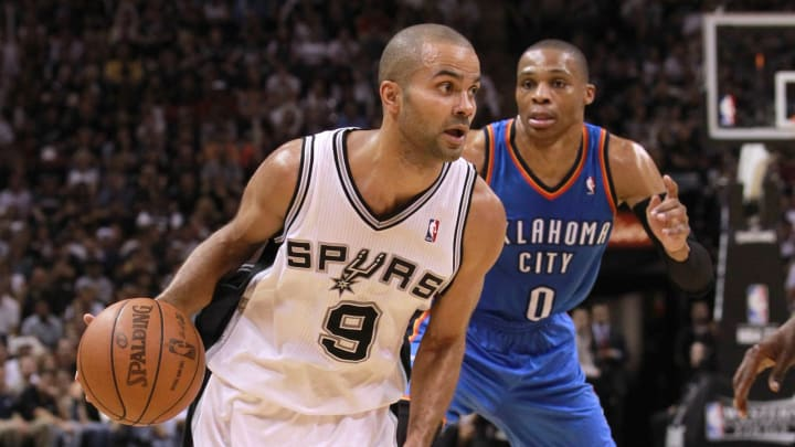 SAN ANTONIO, TX – MAY 29: Tony Parker #9 of the San Antonio Spurs drives ahead of Russell Westbrook. (Photo by Ronald Martinez/Getty Images)