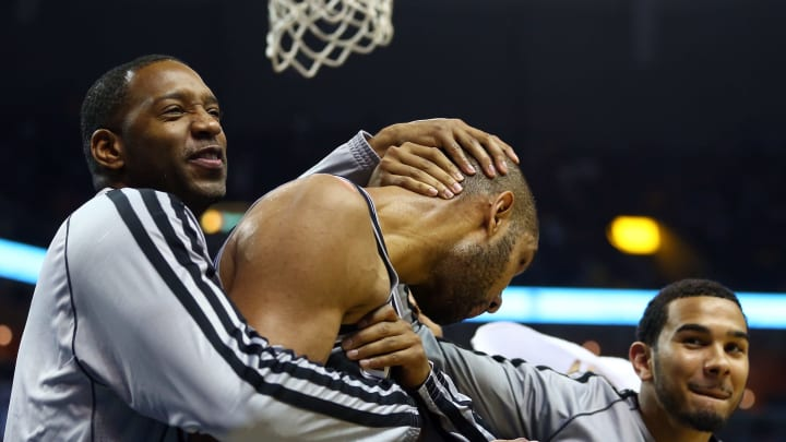 MEMPHIS, TN – MAY 25: Tim Duncan #21 is hugged by teammates Tracy McGrady #1 and Cory Joseph #5 of the San Antonio Spurs. (Photo by Ronald Martinez/Getty Images)
