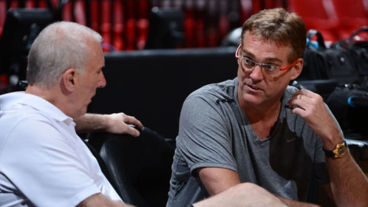 MIAMI, FL - JUNE 7: Head Coach Gregg Popovich speaks with General Manager R.C. Buford of the San Antonio Spurs during practice as part of the 2013 NBA Finals on June 7, 2013 at American Airlines Arena in Miami, Florida. NOTE TO USER: User expressly acknowledges and agrees that, by downloading and or using this photograph, User is consenting to the terms and conditions of the Getty Images License Agreement. Mandatory Copyright Notice: Copyright 2013 NBAE (Photo by Garrett W. Ellwood/NBAE via Getty Images)
