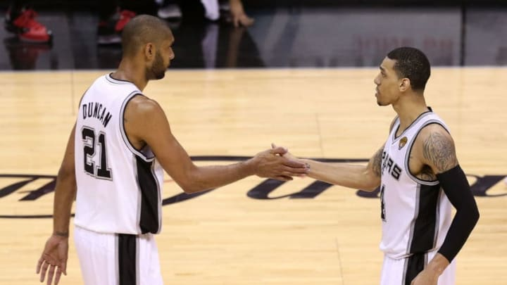 SAN ANTONIO, TX - JUNE 11: Tim Duncan #21 and Danny Green #4 of the San Antonio Spurs celebrate in the second half while taking on the Miami Heat during Game Three of the 2013 NBA Finals at the AT&T Center on June 11, 2013 in San Antonio, Texas. NOTE TO USER: User expressly acknowledges and agrees that, by downloading and or using this photograph, User is consenting to the terms and conditions of the Getty Images License Agreement. (Photo by Christian Petersen/Getty Images)