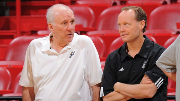 MIAMI, FL – JUNE 19: Head Coach Gregg Popovich speaks to Assistant Coach Mike Budenholzer of the San Antonio Spurs during practice as part of the 2013 NBA Finals on June 19, 2013 at American Airlines Arena in Miami, Florida. (Photo by Andrew D. Bernstein/NBAE via Getty Images)