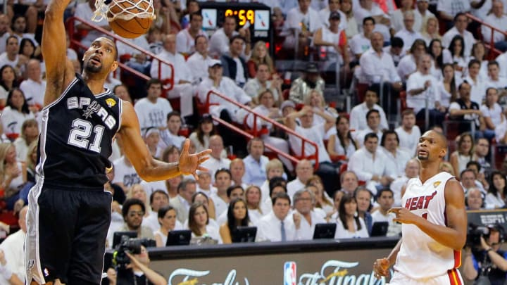 MIAMI, FL – JUNE 20: Tim Duncan #21 of the San Antonio Spurs dunks the ball in front of Chris Bosh #1 of the Miami Heat in the first half during Game Seven of the 2013 NBA Finals (Photo by Kevin C. Cox/Getty Images)