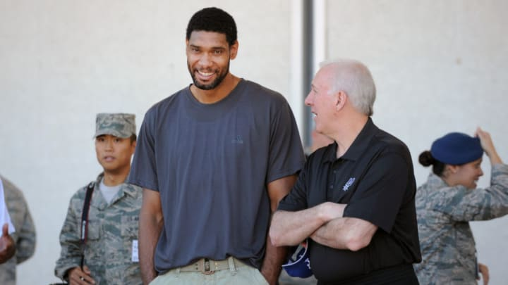 DENVER, CO - October 3: Tim Duncan #21 and head coach Gregg Popovich of the San Antonio Spurs share a laugh before having lunch with the cadets of the United States Air Force Academy in Colorado Springs, Colorado. NOTE TO USER: User expressly acknowledges and agrees that, by downloading and/or using this Photograph, user is consenting to the terms and conditions of the Getty Images License Agreement. Mandatory Copyright Notice: Copyright 2013 NBAE (Photo by Bart Young/NBAE via Getty Images)