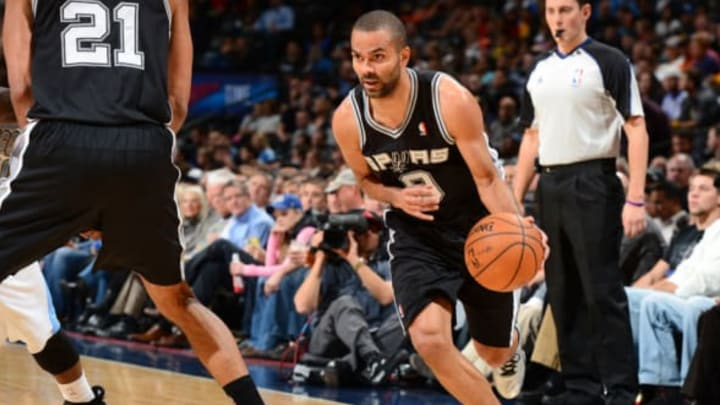 DENVER, CO – NOVEMBER 5: Tony Parker #9 of the San Antonio Spurs drives to the basket against the Denver Nuggets on November 5, 2013 at the Pepsi Center in Denver, Colorado. NOTE TO USER: User expressly acknowledges and agrees that, by downloading and/or using this Photograph, user is consenting to the terms and conditions of the Getty Images License Agreement. Mandatory Copyright Notice: Copyright 2013 NBAE (Photo by Garrett W. Ellwood/NBAE via Getty Images)
