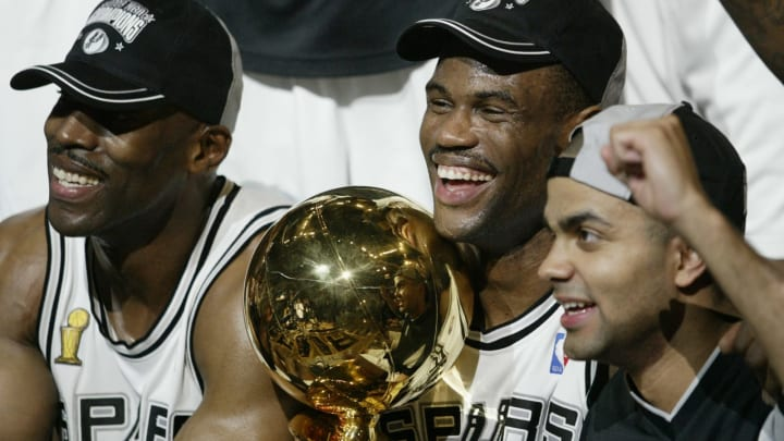 SAN ANTONIO, TX – JUNE 15: David Robinson #50 and Tony Parker #9 of the San Antonio Spurs celebrate after winning Game six of the 2003 NBA Finals (Photo by Jed Jacobsohn/Getty Images)