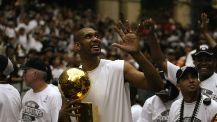 SAN ANTONIO - JUNE 18: Tim Duncan #21 of the San Antonio Spurs celebrates with the 2003 NBA Championship trophy during the SBC 2003 Spurs Championship Celebration (Photo by Ronald Martinez/Getty Images)