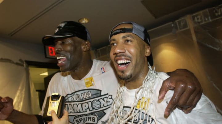 SAN ANTONIO, TX - JUNE 15: (L-R) Kevin Willis #42 and Bruce Bowen #12 of the San Antonio Spurs celebrate defeating the New Jersey Nets in game six of the 2003 NBA Finals on June 15, 2003 at the SBC Center in San Antonio, Texas. The Spurs won 88-77 and defeated the Nets to win the NBA Championship. NOTE TO USER: User expressly acknowledges and agrees that, by downloading and/or using this Photograph, User is consenting to the terms and conditions of the Getty Images License Agreement. (Photo by Ezra Shaw/Getty Images)