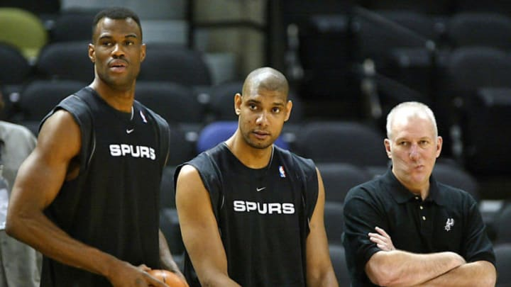 David Robinson (L) Tim Duncan (C) and head coach Gregg Popovich (R) of the San Antonio Spurs watch the rest of their team practice for the NBA finals 05 June, 2003 at the SBC Center in San Antonio, Texas. The Spurs beat the New Jersey Nets in game one 04 June 2003 to lead the best-of seven game series 1-0. AFP PHOTO/Jeff HAYNES (Photo credit should read JEFF HAYNES/AFP via Getty Images)