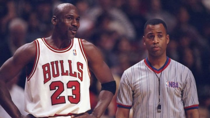 27 Dec 1997: Guard Michael Jordan of the Chicago Bulls confers with an official during a game against the Atlanta Hawks at the United Center in Chicago, Illinois. The Bulls won the game, 97-90. Mandatory Credit: Jonathan Daniel /Allsport