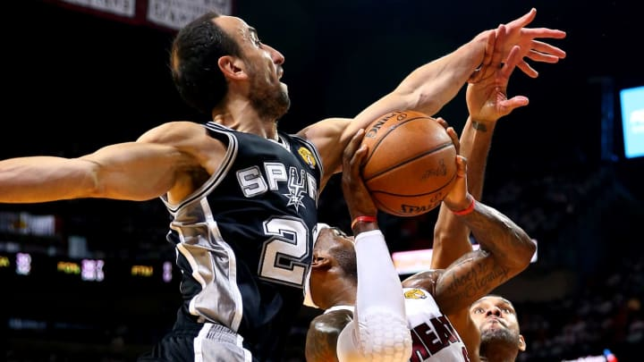 MIAMI, FL – JUNE 12: Manu Ginobili #20 of the San Antonio Spurs defends against LeBron James #6 of the Miami Heat during Game Four of the 2014 NBA Finals at American Airlines Arena. (Photo by Andy Lyons/Getty Images)