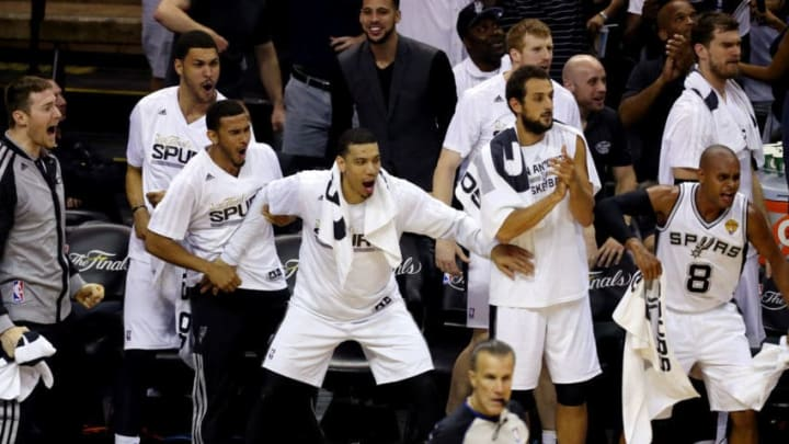 SAN ANTONIO, TX - JUNE 15: The San Antonio Spurs bench reacts against the Miami Heat during Game Five of the 2014 NBA Finals at the AT&T Center on June 15, 2014 in San Antonio, Texas. NOTE TO USER: User expressly acknowledges and agrees that, by downloading and or using this photograph, User is consenting to the terms and conditions of the Getty Images License Agreement. (Photo by Chris Covatta/Getty Images)