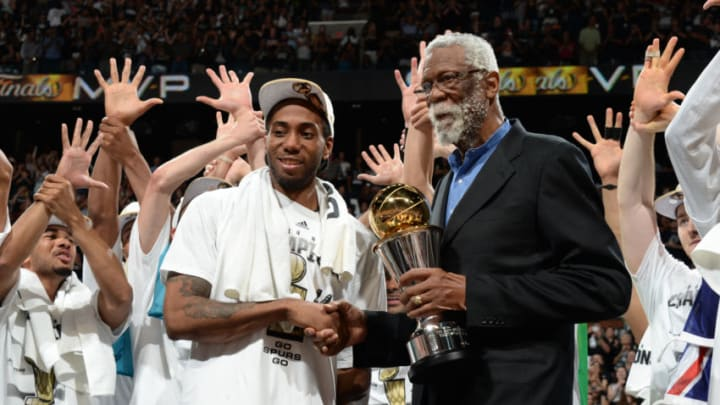 SAN ANTONIO, TX - JUNE 15: Bill Russell presents the Bill Russell MVP Trophy to Kawhi Leonard #2 of the San Antonio Spurs (Photo by Andrew D Bernstein/NBAE via Getty Images)