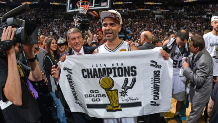 SAN ANTONIO, TX - JUNE 15: Tony Parker #9 of the San Antonio Spurs celebrates winning the 2014 NBA Championship after Game Five of the 2014 NBA Finals against the Miami Heat on June 15, 2014 at AT&T Center in San Antonio, Texas. NOTE TO USER: User expressly acknowledges and agrees that, by downloading and or using this photograph, User is consenting to the terms and conditions of the Getty Images License Agreement. Mandatory Copyright Notice: Copyright 2014 NBAE (Photo by Jesse D. Garrabrant/NBAE via Getty Images)