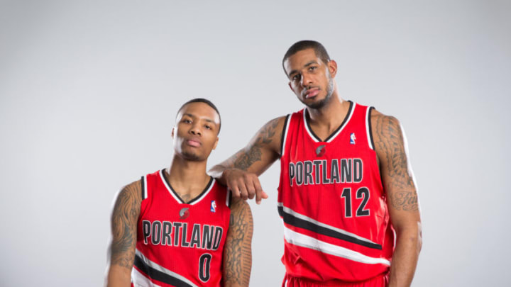 PORTLAND, OR - JANUARY 13: Damian Lillard #0 and LaMarcus Aldridge #12 of the Portland Trailblazers pose for a portrait on January 13, 2014 at the Moda Center in Portland, Oregon. NOTE TO USER: User expressly acknowledges and agrees that, by downloading and or using this photograph, User is consenting to the terms and conditions of the Getty Images License Agreement. Mandatory Copyright Notice: Copyright 2014 NBAE (Photo by Sam Forencich/NBAE via Getty Images)