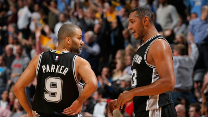 DENVER, CO - JANUARY 20: Tony Parker #9 and Boris Diaw #33 of the San Antonio Spurs talk during a break in the action against the Denver Nuggets at Pepsi Center on January 20, 2015 in Denver, Colorado. The Spurs defeated the Nuggets 109-99. NOTE TO USER: User expressly acknowledges and agrees that, by downloading and or using this photograph, User is consenting to the terms and conditions of the Getty Images License Agreement. (Photo by Doug Pensinger/Getty Images)