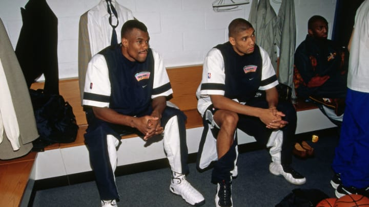 NEW YORK CITY - FEBRUARY 8: Tim Duncan and David Robinson of the Western Conference All-Stars sit in the lockerroom prior to the 1998 NBA All-Star Game on February 8, 1998 at Madison Square Garden in New York City. NOTE TO USER: User expressly acknowledges and agrees that, by downloading and or using this photograph, User is consenting to the terms and conditions of the Getty Images License Agreement. Mandatory Copyright Notice: Copyright 1998 NBAE (Photo by Vince Manniello/NBAE via Getty Images)