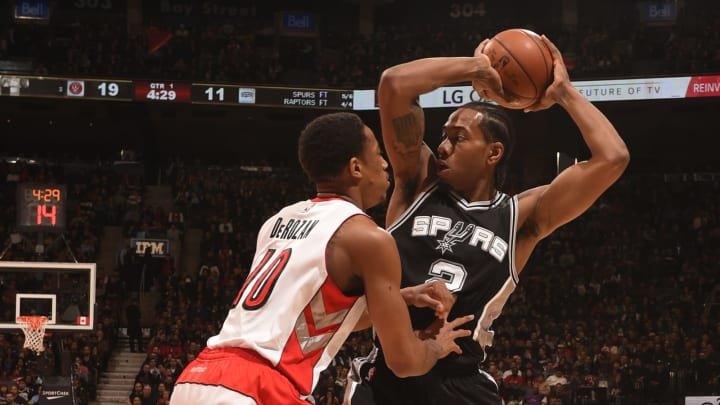 TORONTO, ON – FEBRUARY 8: Kawhi Leonard #2 of the San Antonio Spurs handles the ball against DeMar DeRozan #10 of the Toronto Raptors on February 8, 2015 at the Air Canada Centre in Toronto, Ontario, Canada. (Photo by Ron Turenne/NBAE via Getty Images)