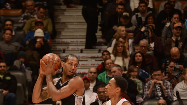 TORONTO, ON - FEBRUARY 8: Kawhi Leonard #2 of the San Antonio Spurs handles the ball against DeMar DeRozan #10 of the Toronto Raptors on February 8, 2015 at the Air Canada Centre in Toronto, Ontario, Canada. NOTE TO USER: User expressly acknowledges and agrees that, by downloading and or using this Photograph, user is consenting to the terms and conditions of the Getty Images License Agreement. Mandatory Copyright Notice: Copyright 2015 NBAE (Photo by Ron Turenne/NBAE via Getty Images)