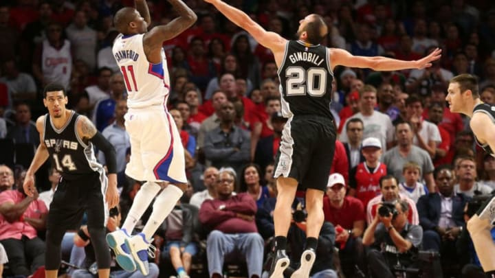 LOS ANGELES, CA - APRIL 28: Jamal Crawford #11 of the Los Angeles Clippers shoots over Manu Ginobili #20 of the San Antonio Spurs during Game Five of the Western Conference quarterfinals of the 2015 NBA Playoffs at Staples Center on April 28, 2015 in Los Angeles, California. NOTE TO USER: User expressly acknowledges and agrees that, by downloading and or using this photograph, User is consenting to the terms and conditions of the Getty Images License Agreement. (Photo by Stephen Dunn/Getty Images)