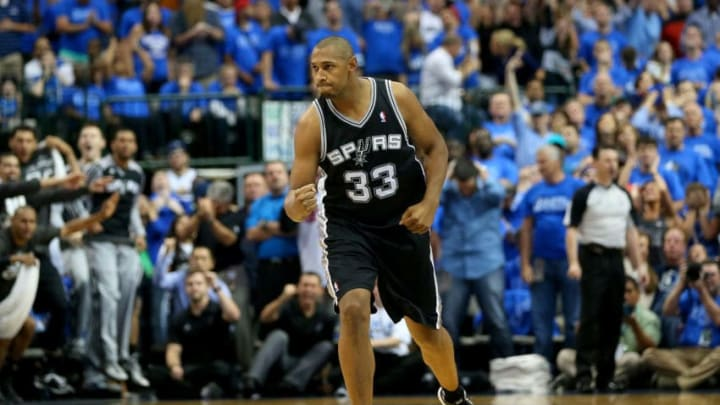 DALLAS, TX - APRIL 28: Boris Diaw #33 of the San Antonio Spurs reacts after making a three point shot against the Dallas Mavericks in Game Four of the Western Conference Quarterfinals during the 2014 NBA Playoffs at American Airlines Center on April 28, 2014 in Dallas, Texas. NOTE TO USER: User expressly acknowledges and agrees that, by downloading and or using this photograph, User is consenting to the terms and conditions of the Getty Images License Agreement. (Photo by Ronald Martinez/Getty Images)