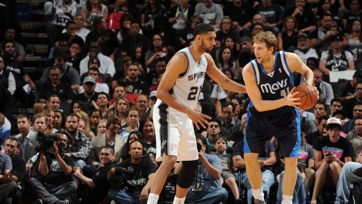 SAN ANTONIO, TX – APRIL 30: Dirk Nowitzki #41 of the Dallas Mavericks looks to control the ball against Tim Duncan #21 of the San Antonio Spurs in Game Five of the First Round (Photo by Garrett W. Ellwood/NBAE via Getty Images)