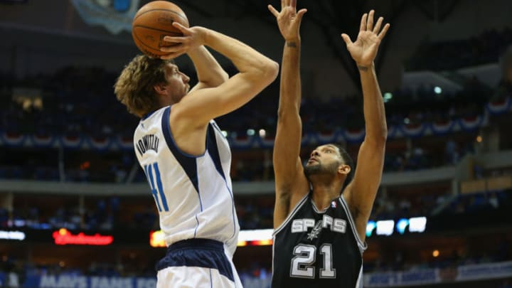 DALLAS, TX - MAY 02: Dirk Nowitzki #41 of the Dallas Mavericks takes a shot against Tim Duncan #21 of the San Antonio Spurs in Game Six of the Western Conference Quarterfinals during the 2014 NBA Playoffs at American Airlines Center on May 2, 2014 in Dallas, Texas. NOTE TO USER: User expressly acknowledges and agrees that, by downloading and or using this photograph, User is consenting to the terms and conditions of the Getty Images License Agreement. (Photo by Ronald Martinez/Getty Images)